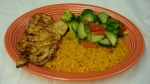 Pollo Mexicano - Grilled chicken breast seasoned with orange juice. Served with grilled vegetables, tossed salad and rice.